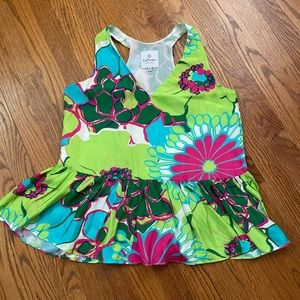 La Roque silk top with ruffle hem. Lined.